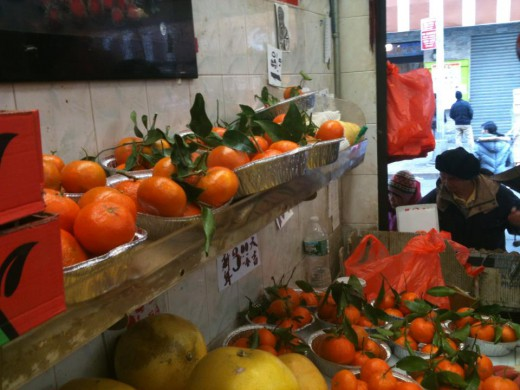 Every produce stand in Chinatown is ladened with lucky tangerines, oranges, and pomelos for New Years.