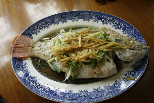 The Cantonese insist on serving fish for New Year's Eve dinner because it represents abundance. And because fish swim in pairs they are regarded as a symbol of marital bliss.